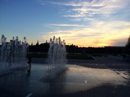 kid splashing in fountain at Curtis Hixon park . Sunset